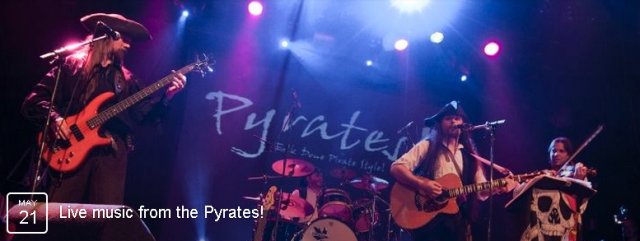 Pyrates! be a sea faring band of Musical Marauders, sailing from th' shores of the Olde Lowlands of Holland to rowdy ports across the world! A notorious band of buccaneers, who've imposed their own brand of pirate themed folk music to fellow pirates an' unfortunate landlubbers.